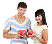 Beautiful loving couple with hearts isolated on white — Stock Photo