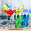 Different  colorful cocktails on bright background — Stock Photo