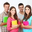 Group of happy beautiful young students at room — Stock Photo #28599951