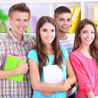 Group of happy beautiful young students at room — Stock Photo #28599961