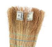 Broom sweep the dollars close-up — Stock Photo