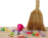 Broom sweep the trash after a party on white background close-up — Stock Photo