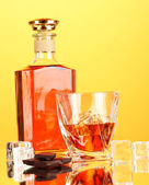 Bottle and two glasses of scotch whiskey, on color background — Stock Photo