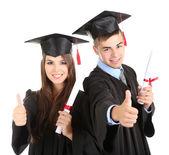 Deux étudiants diplômés heureux isolés sur blanc — Photo