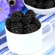 Sweet blackberries in cup on table close-up — Foto de Stock