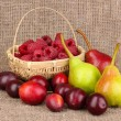 Ripe sweet fruits and berries on sackcloth — Stock Photo
