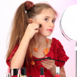Little girl in her mother's dress, is trying painting her face — Stock Photo #28604781