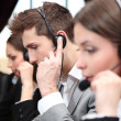 Stock Photo: Call center operators at wor