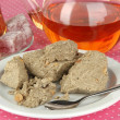 Stock Photo: Tasty halva with tea on table close-up