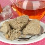 Tasty halva with tea on table close-up — Stock Photo