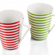 Cups on grey background — Stock Photo
