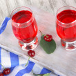 Glasses compote on board on napkin on wooden table — Stock Photo