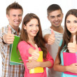 Group of happy beautiful young students at room — Stock Photo #28605593