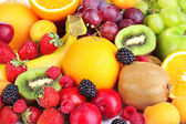 Fresh fruits and berries close up — Stock Photo