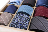Neckties in wooden box close-up — Stock Photo