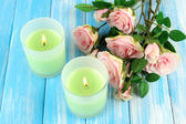 Candles on wooden table close-up — Stock fotografie