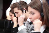 Call center operators at wor — Stock Photo