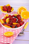 Useful fruit salad in plates on wooden table close-up — Stock Photo