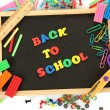 Stockfoto: Small chalkboard with school supplies on white background. Back to School