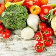 Fresh vegetables in basket on wooden table close-up — Stock Photo #28643483