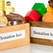 Donation box with food and children's toys on white background close-up — Stock Photo #28647289