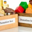 Donation box with food and children's toys on white background close-up — Stock Photo