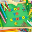 Small chalkboard with school supplies on white background. Back to School — Stock Photo
