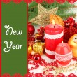Red candle with Christmas decoration on light background — Stock Photo
