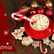 Cup of coffee with Christmas sweetness on wooden table close-up — Stock Photo #28647663