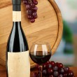 Composition of wine, wooden barrel and grape, on bright background — Stock Photo #28647827