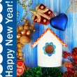 Nesting box and Christmas decorations on blue background — Stock Photo