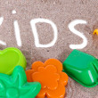 Various children's toys on sand — Stock Photo #28648049