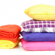 Stock Photo: Bright pillows and plaids, isolated on white