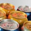 Stock Photo: Metal tins on gray background