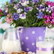 Beautiful bouquet in pail on wooden table on natural background — Stock Photo #28649713