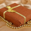 Romantic parcel on gold cloth background — Stock Photo #28649955