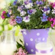 Beautiful bouquet in pail on wooden table on natural background — Stock Photo #28649957