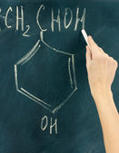 Chemical structure formula written on blackboard with chalk. — Stock Photo