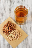 Beer in glass crunches, and nuts on wooden table — Stock Photo