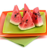 Sweet watermelon slices on plates isolated on white — Stock Photo