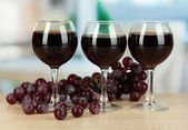 Red wine in glass on room background — Stock Photo