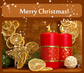 Two candles and christmas decorations, on golden background — Foto Stock