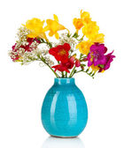 Beautiful bouquet of freesia in blue vase isolated on white — Stock Photo