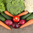 Fresh vegetables on burlap background — Stock Photo