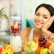 Girl with fresh fruits on room background — Stock Photo #28650711