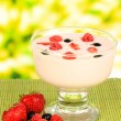 Delicious yogurt with fruit on table on bright background — Stock Photo #28650939
