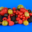 Stock Photo: Ripe berries on blue background