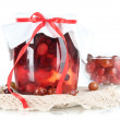 Stock Photo: Yummy jam in bank on napkin isolated on white