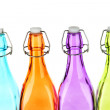 Colorful bottles isolated on white — Stock Photo