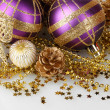 Beautiful purple Christmas balls and cones isolated on white — Stock Photo